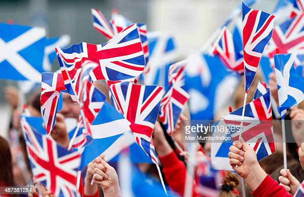 School children wave Union Flags and Saltires at the opening of the new Scottish Border's Railway at Tweedbank Station on September 9 2015 in...