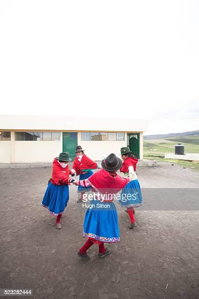 school children (6-7) wearing traditional ecuadorian costume, ecuador - hugh sitton stock pictures, royalty-free photos & images