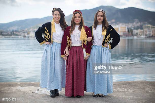 School children wearing traditional island dress pose as they wait for the Independence Day parade on March 25 2016 in Mytilene Greece The annual...