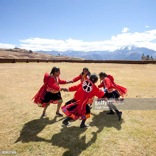 School children wearing traditional peruvian costume, at school. Chinchero. Peru.