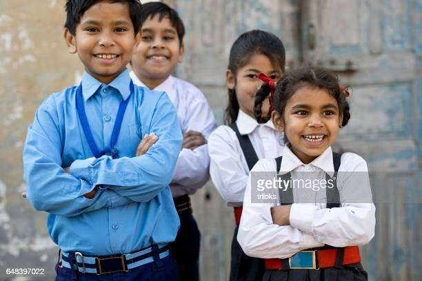 School children with arms crossed