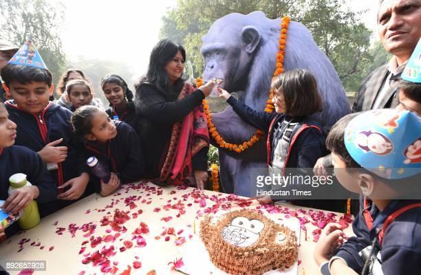 School children with Director of Delhi Zoo celebrate the birthday of Chimpanzee Rita at Delhi zoo on December 14 2017 in New Delhi India