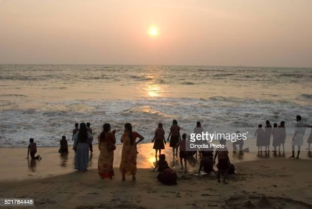 School children with their teachers enjoying sunset at cherai beach, Cochin, Kerala, India