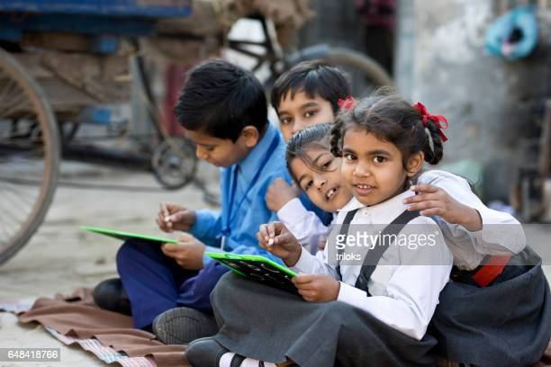School children writing on slate