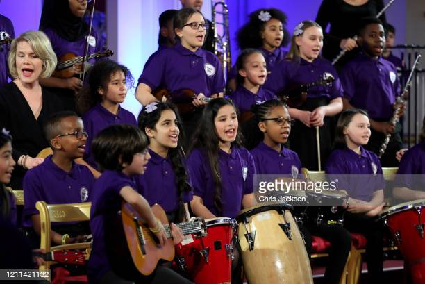 A school choir performs as Catherine Duchess of Cambridge hosts a Gala Dinner in celebration of the 25th anniversary of Place2Be at Buckingham Palace...