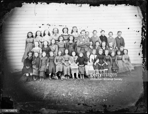 School class with twentysix girls ten boys and male teacher in center Wisconsin 1876