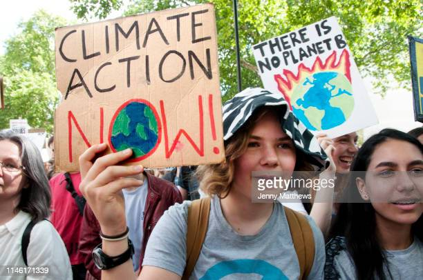 School Climate Strike Parliament SquareLondon England UK A young girl holds a sign saying 'Climate Action Now'