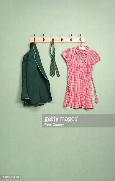 school coat rack in domestic room - schuluniform stock-fotos und bilder