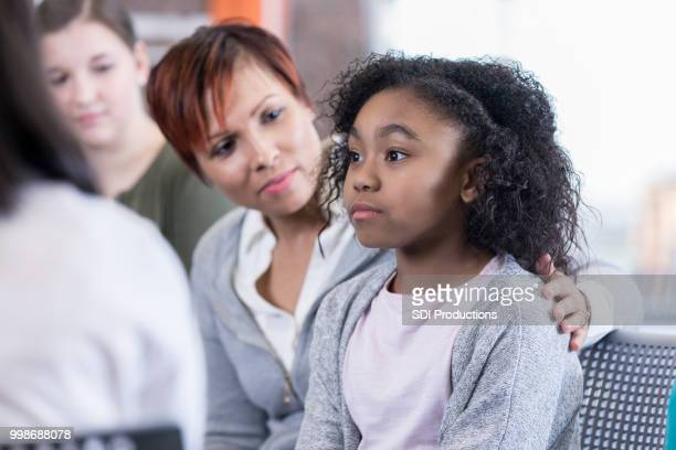 School counselor comforts student