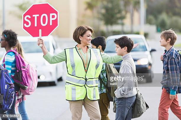 school crossing guard - pedestrian crossing sign stock photos and pictures