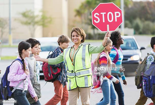 school crossing guard - pedestrian crossing stock photos and pictures