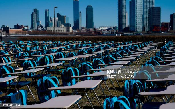 School desks are setup as part of a UNICEF 'Pandemic Classroom',each seat representing one million children living in countries where schools have...