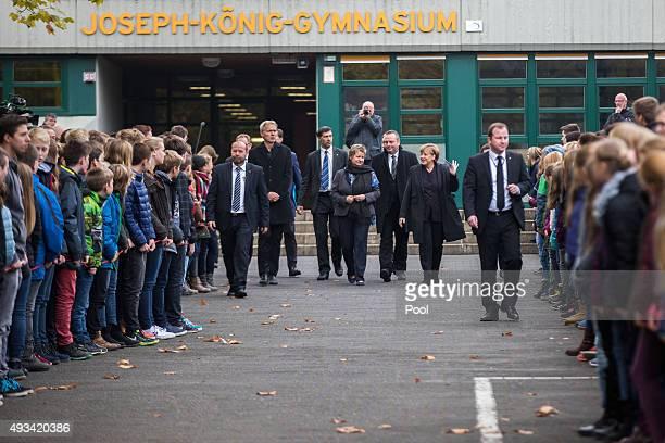 School director Ulrich Wessel NorthrhineWestphalian deputy Prime Minister Sylvia Loehrmann Mayor Bodo Klimpel and German Chancellor Angela Merkel...