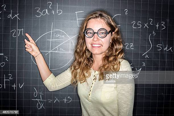 school education portraits: student genius in front of blackboard - geek girl stock photos and pictures