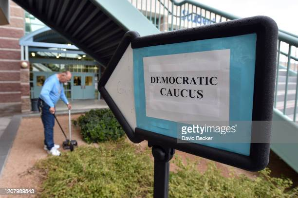 A school employee cleans up prior to the start of the Nevada Democratic Caucus at Centennial High School on February 22 2020 in Las Vegas Nevada...