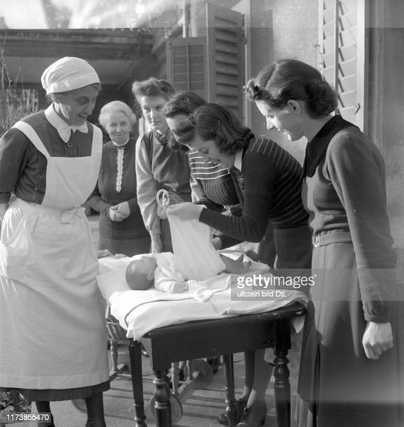 School for mothers in Lucerne: change a babys nappies, 1941