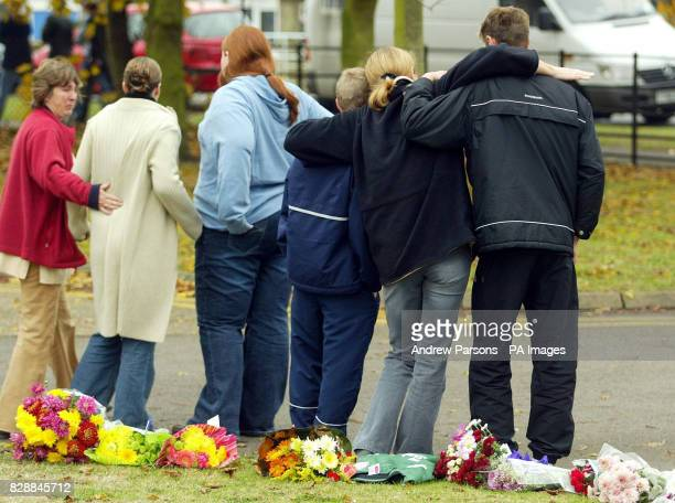 School friends embrace after leaving flowers outside the Birbeck School North Somercotes near Louth Lincolnshire following the stabbing of 14yearold...