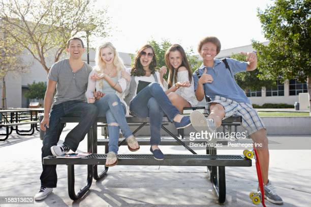 school friends hanging out together - multiculturalism stock pictures, royalty-free photos & images
