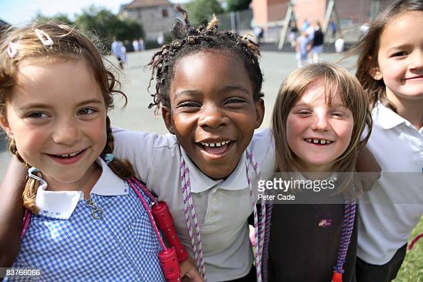 school friends laughing together - primary age child stock pictures, royalty-free photos & images