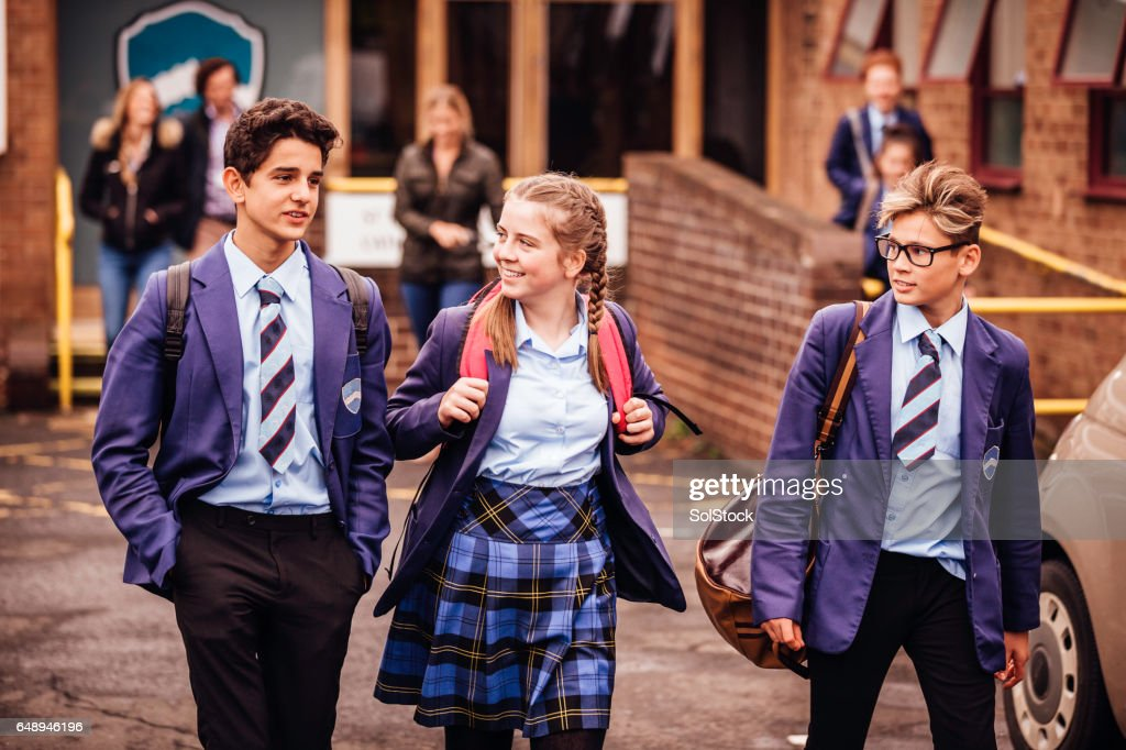 School friends leaving School for the Day : Stock Photo
