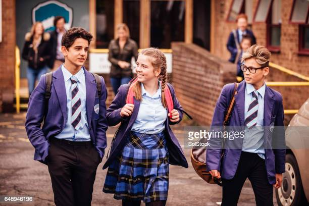 school friends leaving school for the day - schoolboy stock pictures, royalty-free photos & images