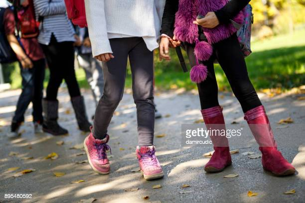 school friends - school girl shoes stock pictures, royalty-free photos & images
