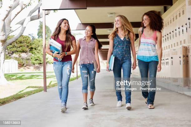 School friends walking in portico