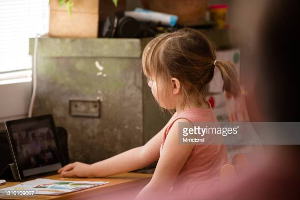 school from home with online class on a digital tablet - mmeemil stock pictures, royalty-free photos & images