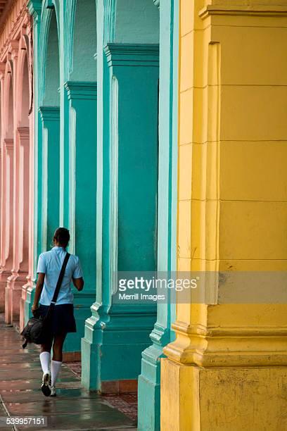 School girl and pastel columns in Havana