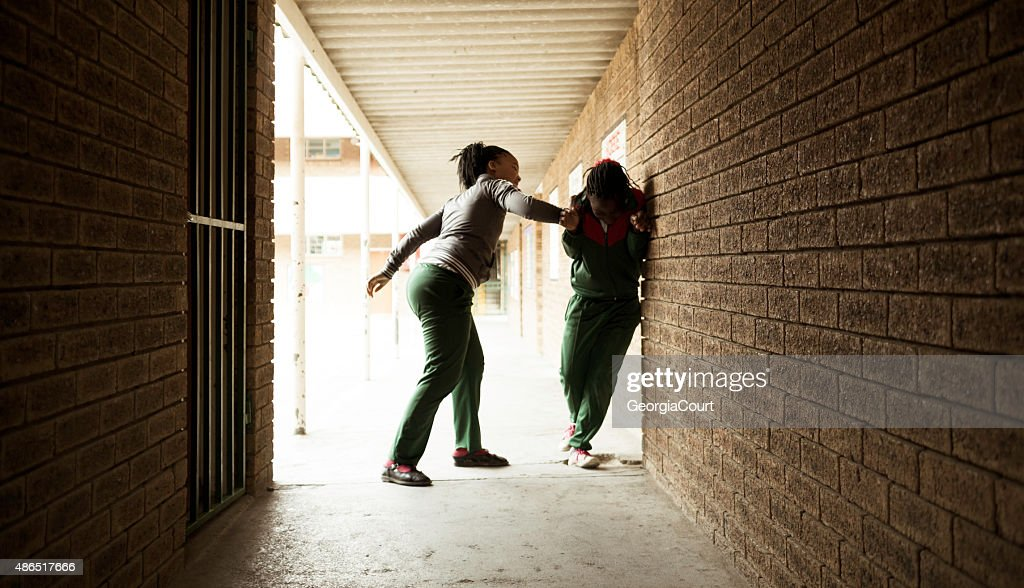 School girl bullies another girl : Stock Photo