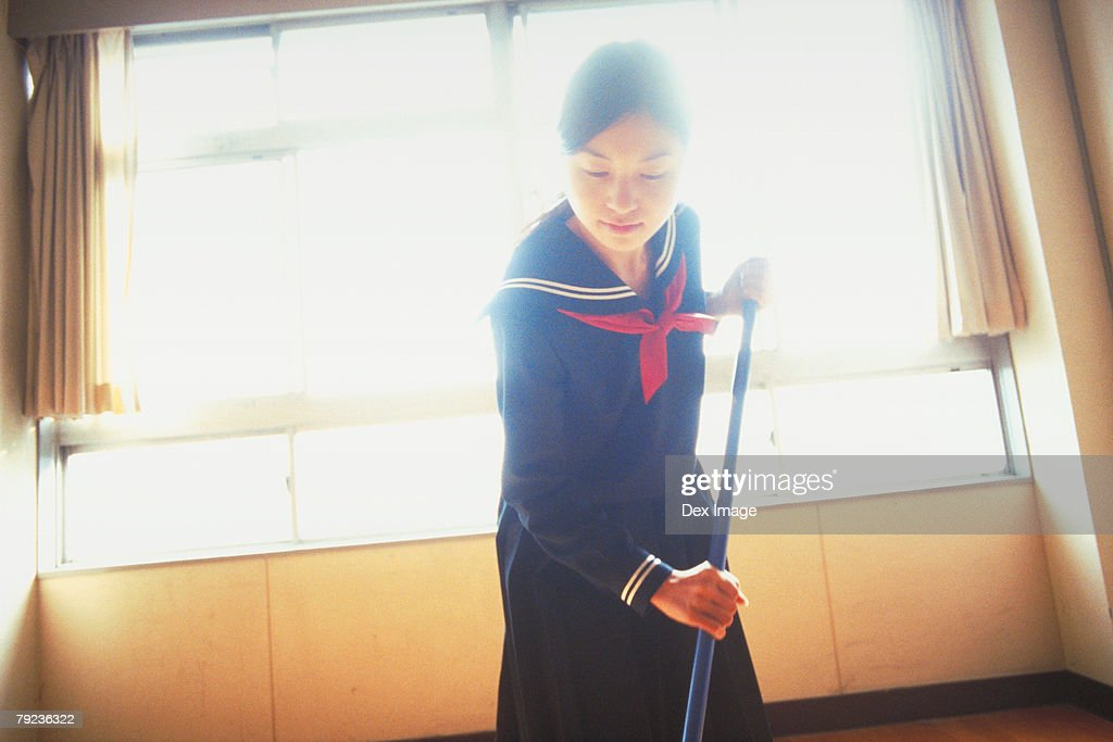 School girl cleaning the classroom : Stock Photo