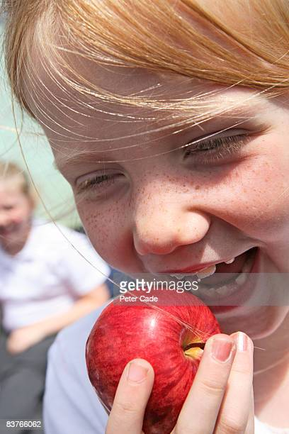 school girl eating apple