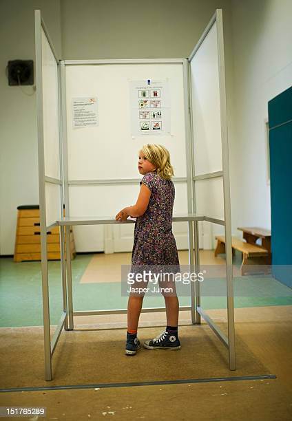 A school girl fills her ballot for the 'Children Elections' held in many Dutch schools in a voting booth used in tomorrows Dutch parliamentary...