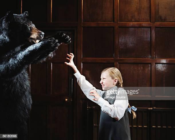 School girl growling at bear