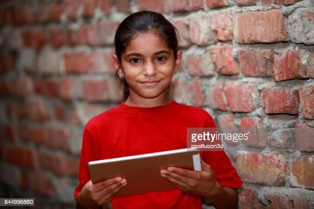 School girl holding digital Tablet
