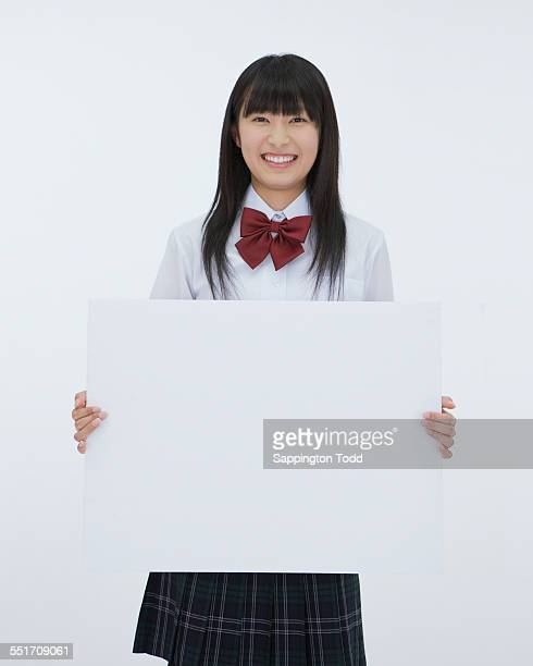 School Girl Holding Placard