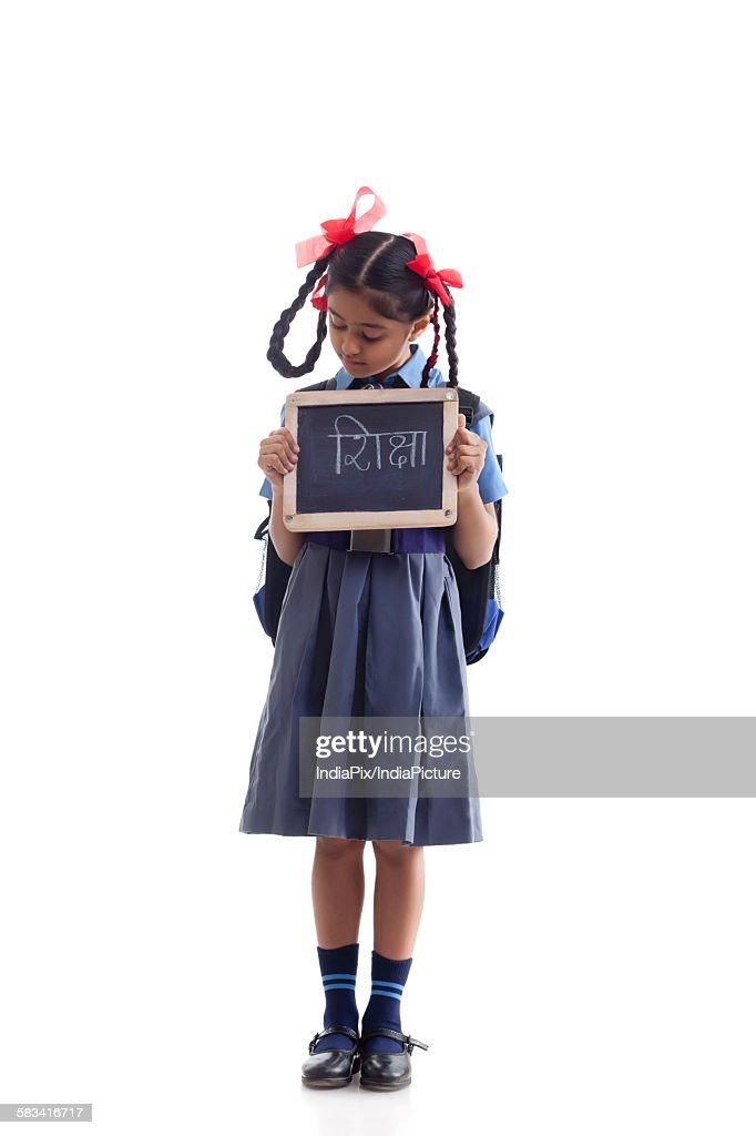 School girl holding slate : Stock Photo