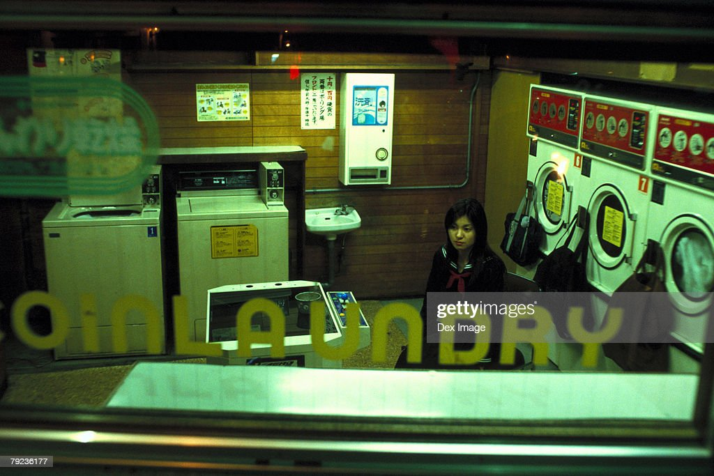 School girl in a laundry shop : Stock Photo