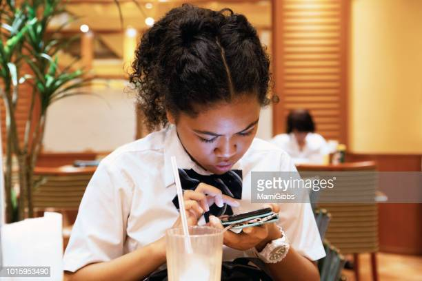 School girl is studying using smartphones