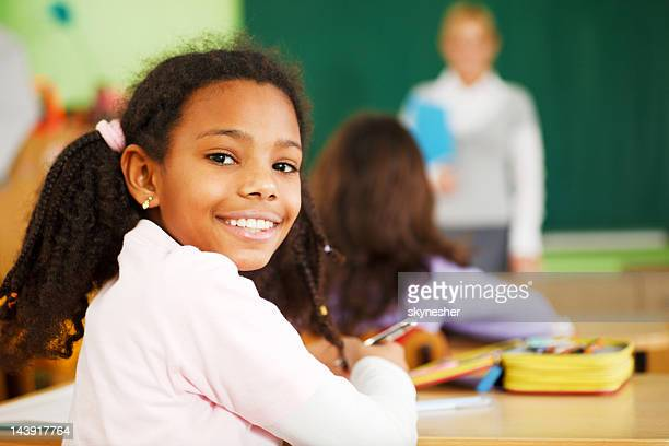 school girl looking behind and smiling. - free images for educational use stock pictures, royalty-free photos & images