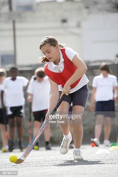 school girl playing hockey
