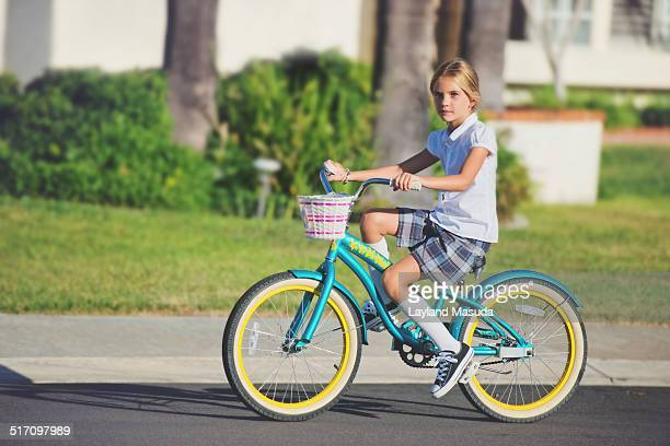 school girl riding her bike - school girl shoes stock pictures, royalty-free photos & images