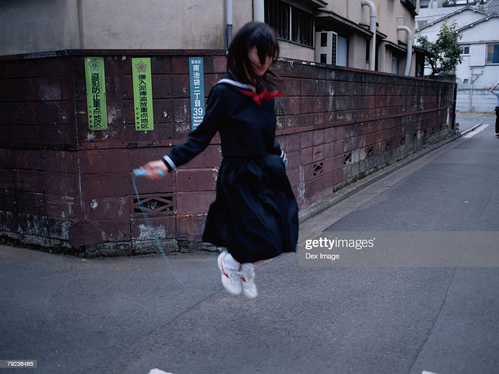 School girl  skipping : Stock Photo