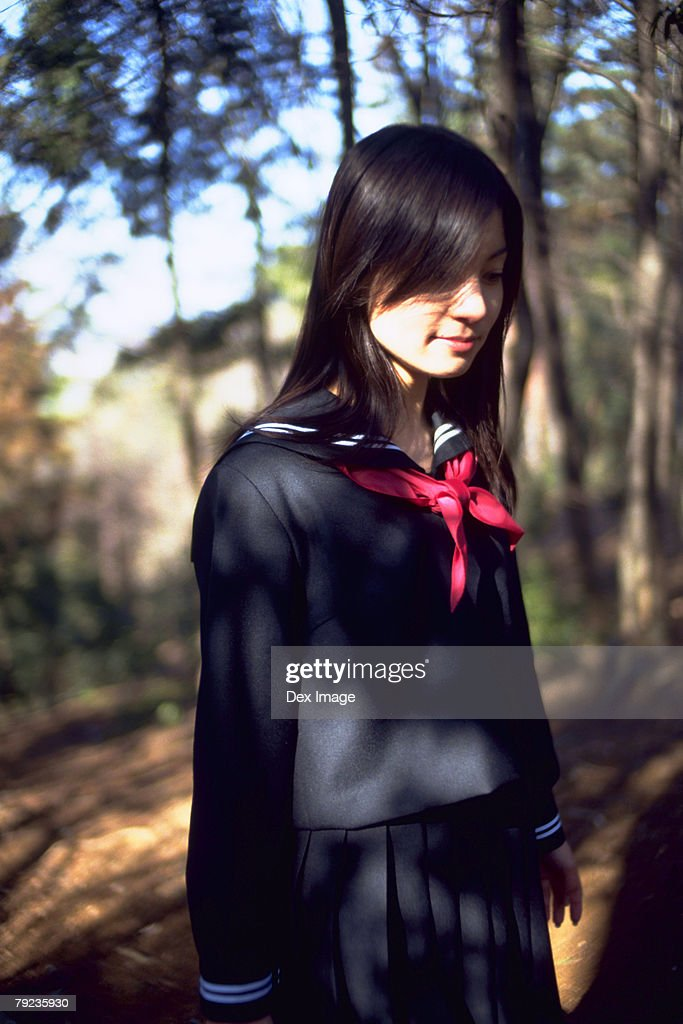 School girl standing in the park : Stock Photo
