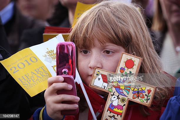 A school girl takes a camera phone photograph of Pope Benedict XVI at The Big Assembly gathering at St Mary's University College during day two of...