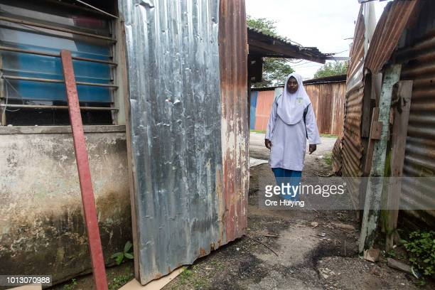 A school girl walks home in a village in Kampung Pisang the site of the 234 acre land acquired by the 1MDB fund on July 31 2018 in Penang Malaysia...