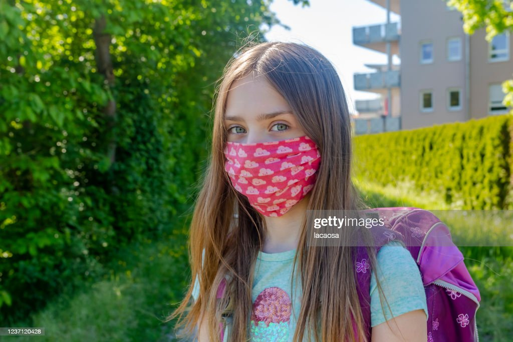 school girl with homemade protective mask : Stock Photo