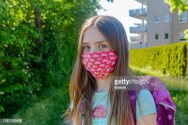 school girl with homemade protective mask - home made stock pictures, royalty-free photos & images