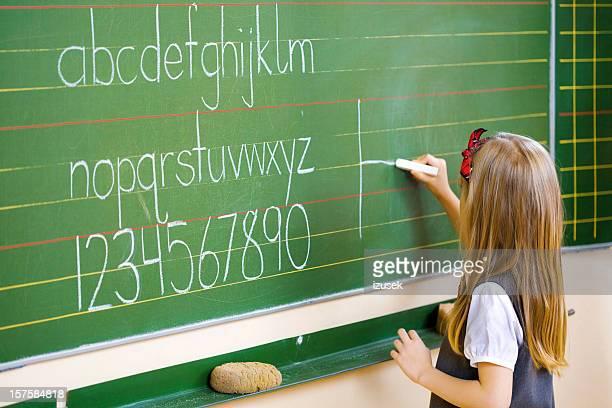 School Girl Writing On Blackboard, Close Up