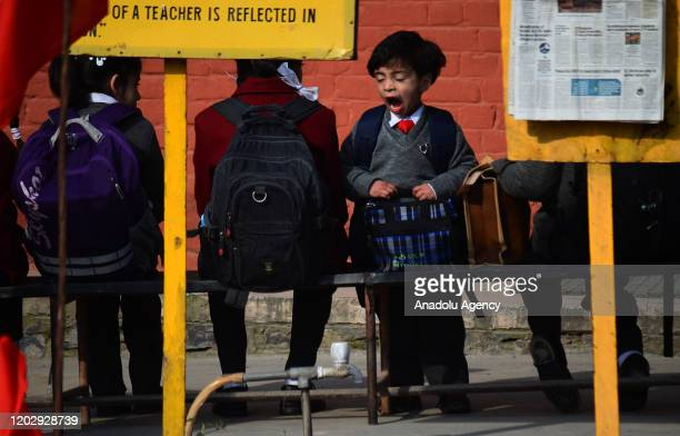 School girl yawns as she is waiting for morning prayers to be held on the first day in Srinagar, Kashmir on February 24, 2020. Schools across the...